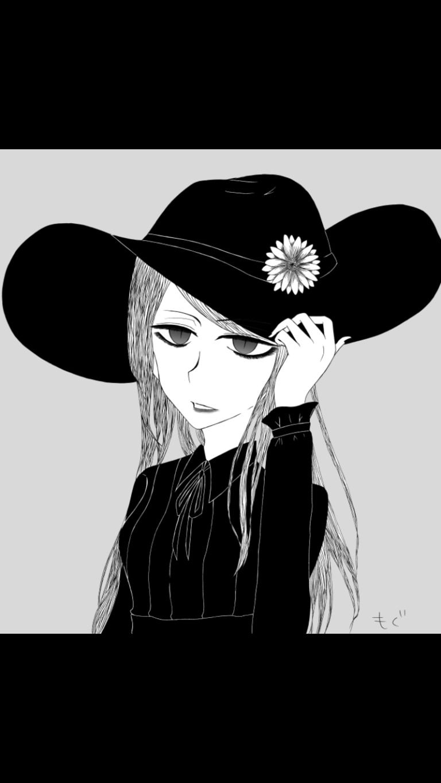 帽子を被った女